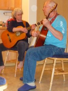 two singers with their guitars