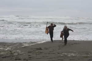 singing duo running from an incoming tide.