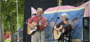 singing duo with their guitars on stage at festival