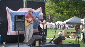 Singing duo with guitars on stage at festival